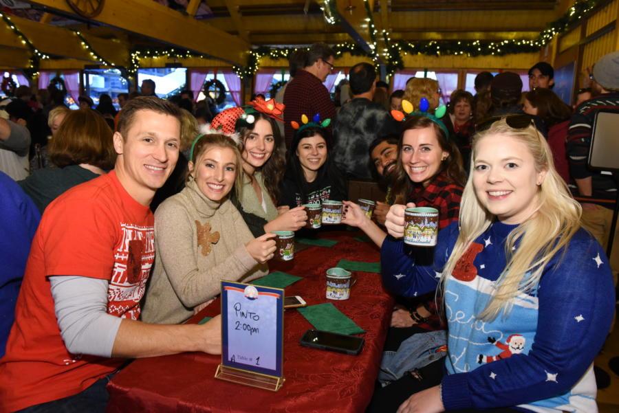 People drinks hot wine at Christkindlmarket