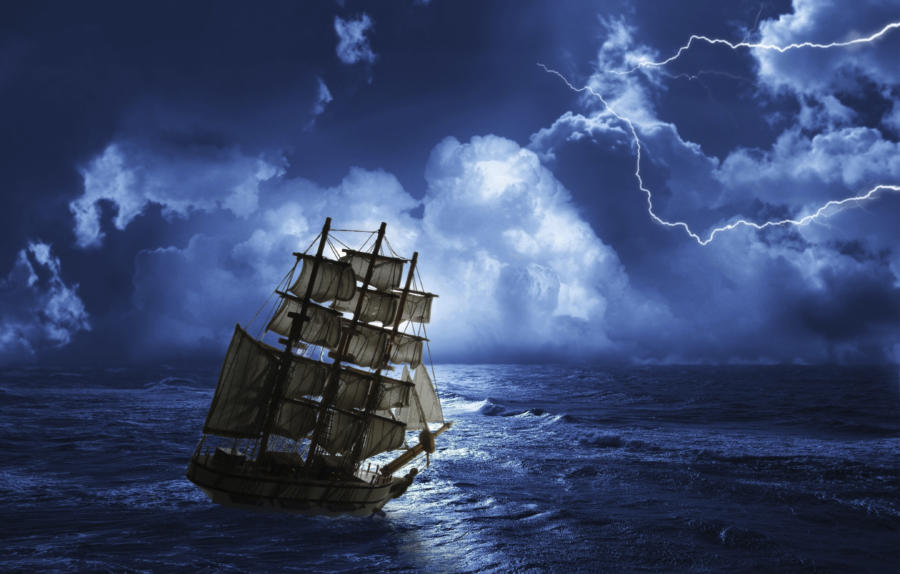 A ship sailing on stormy waters