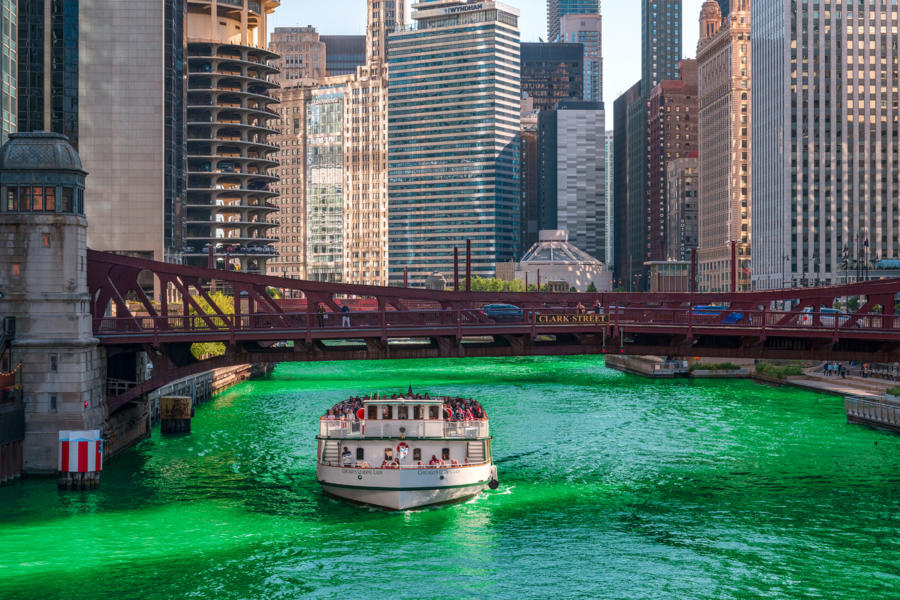 A boat on the green Chicago River on St. Patricks' Day