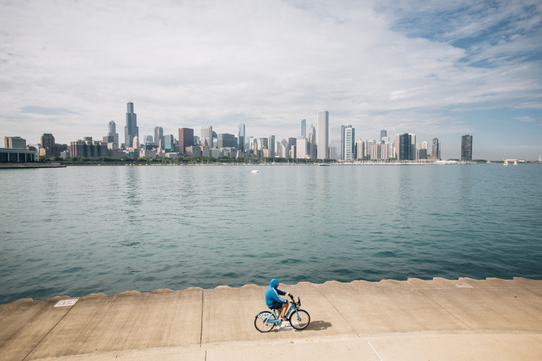 Chicago Skyline with bicyclist along the Lakefront Trail