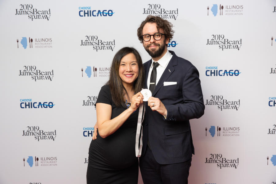Beverly Kim and her husband with their James Beard Award