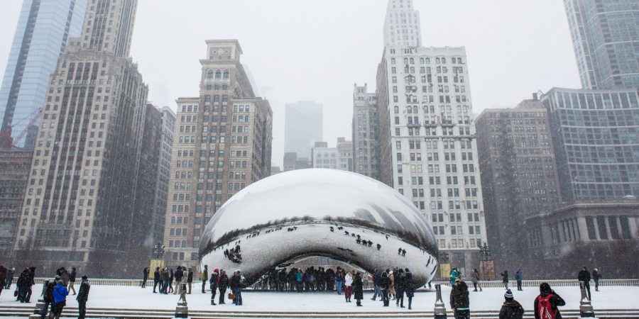 People around Chicago's Cloud Gate, The Bean, in the snow