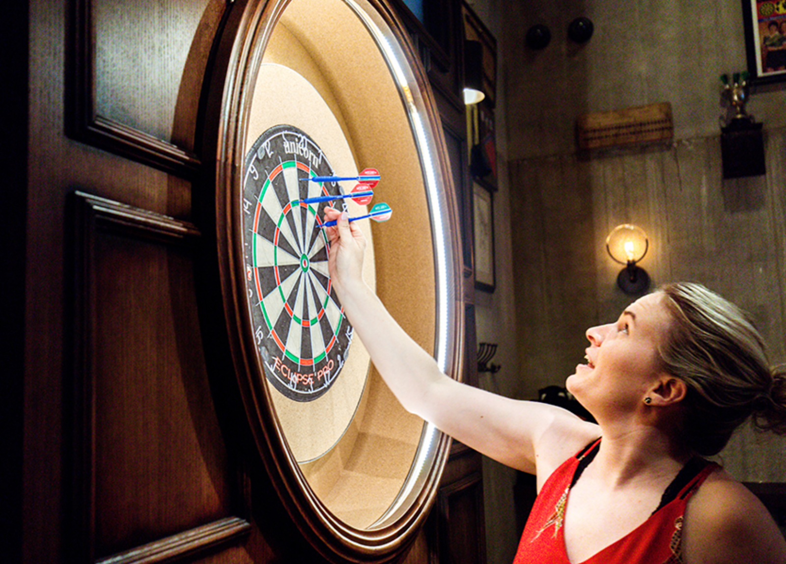 A woman playing darts at Flight Club Darts