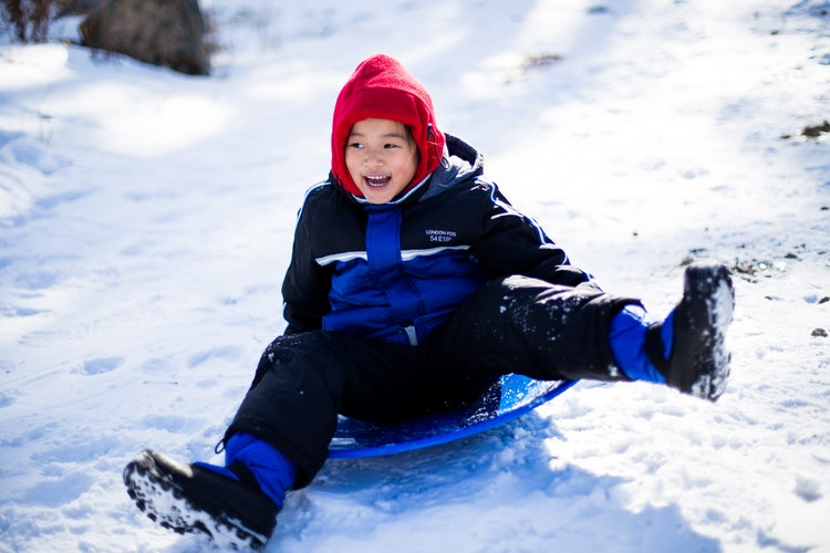 A boy goes sledding