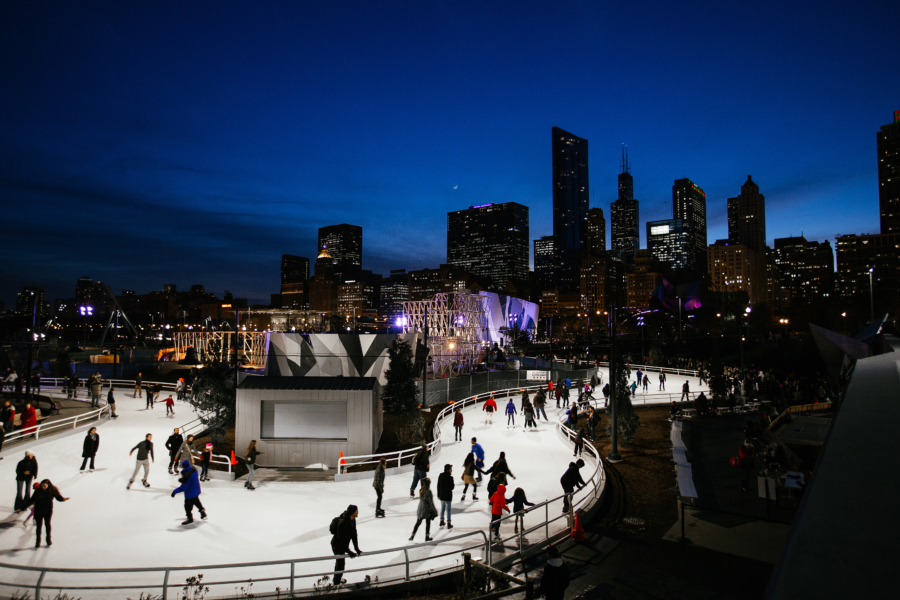 People ice skating along the skating ribbon at Maggie Daley Park in Chicago