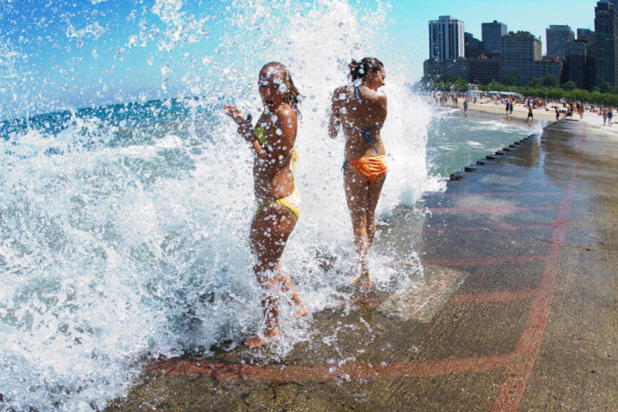 Two girls play in the waves at North Avenue Beach