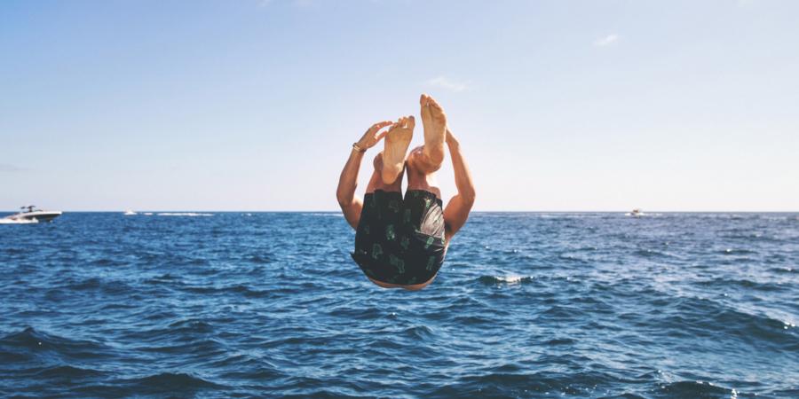 Man jumping into Lake Michigan