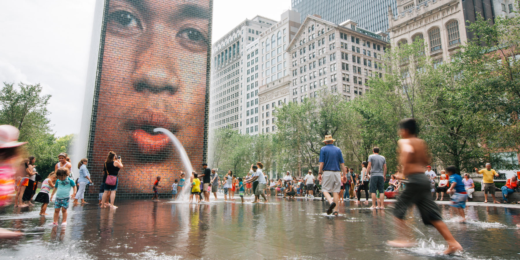 Crown Fountain and kids playing