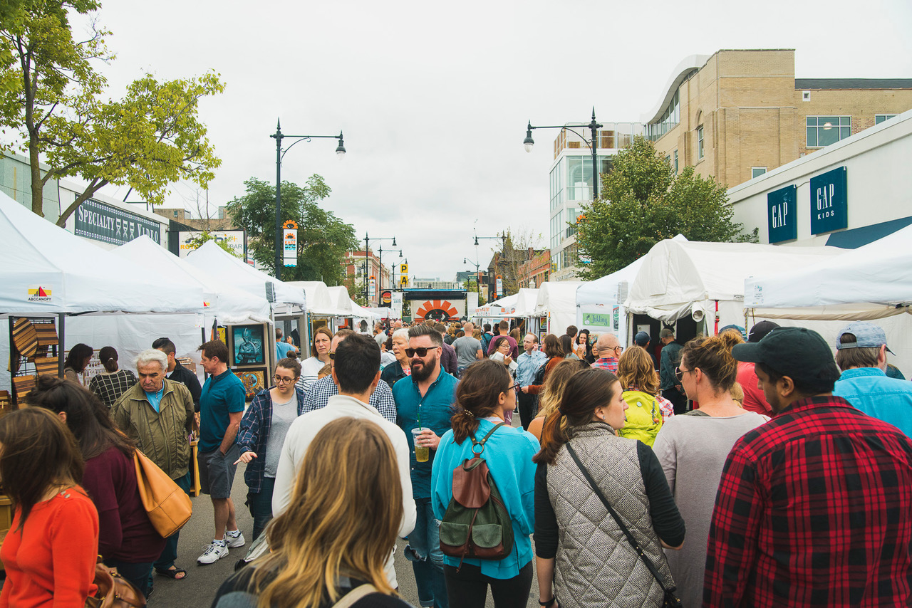 Crowd of people browsing booths at Lakeview East Festival of the Arts in Chicago