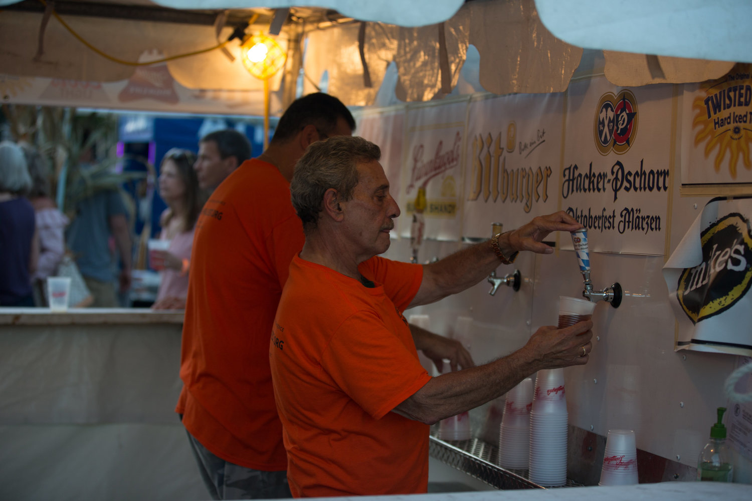 Men pouring beers at the Norwood Park Fall Fest in Chicago
