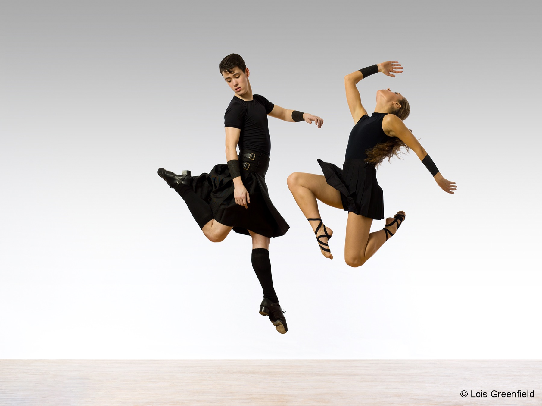 Trinity Irish Dance Company dancers posing during a jump in the air in Chicago