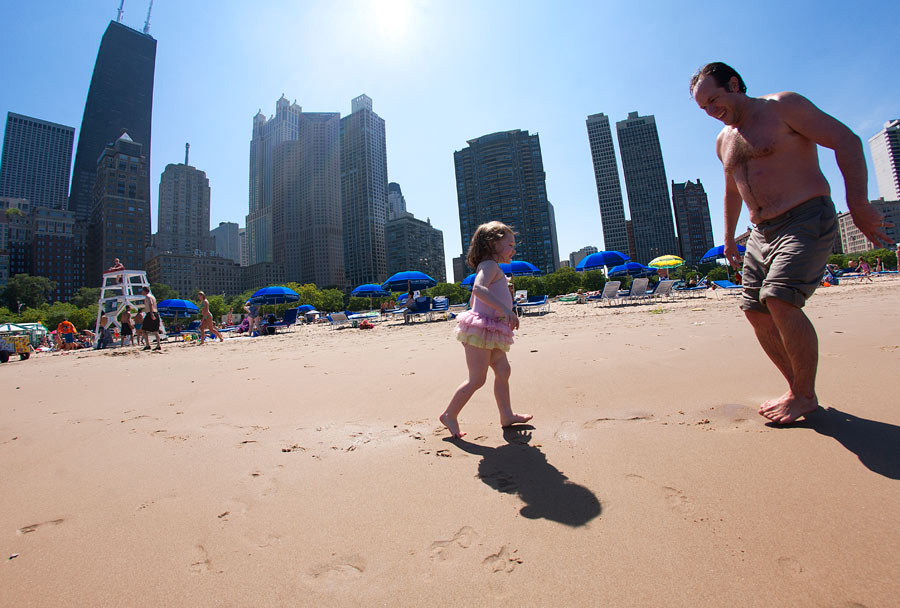 Father and daughter on a beach in Chicago