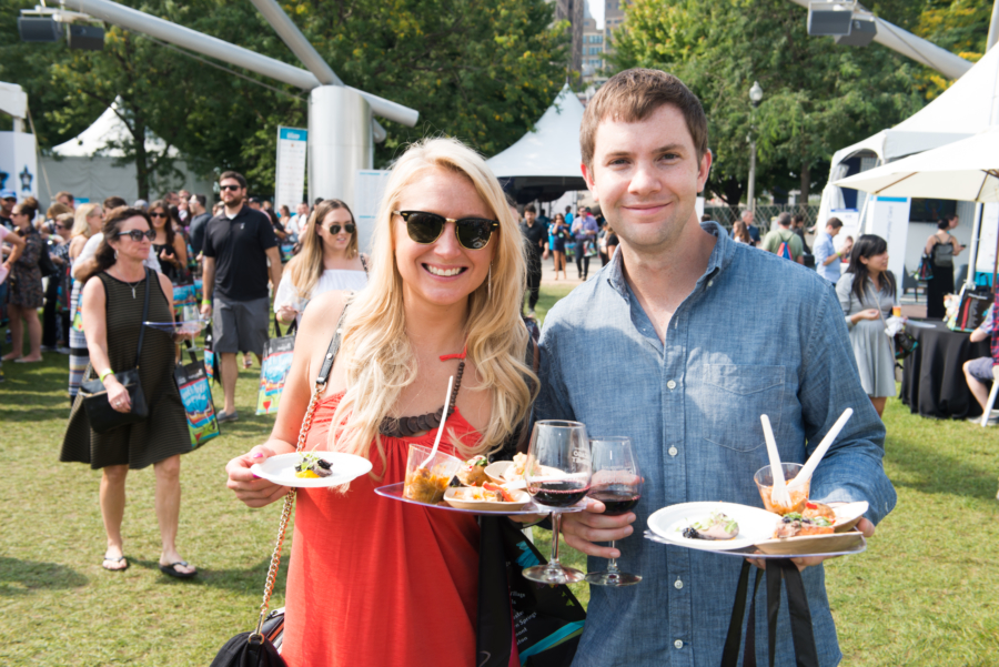 Two people enjoying food and wine at Chicago Gourmet