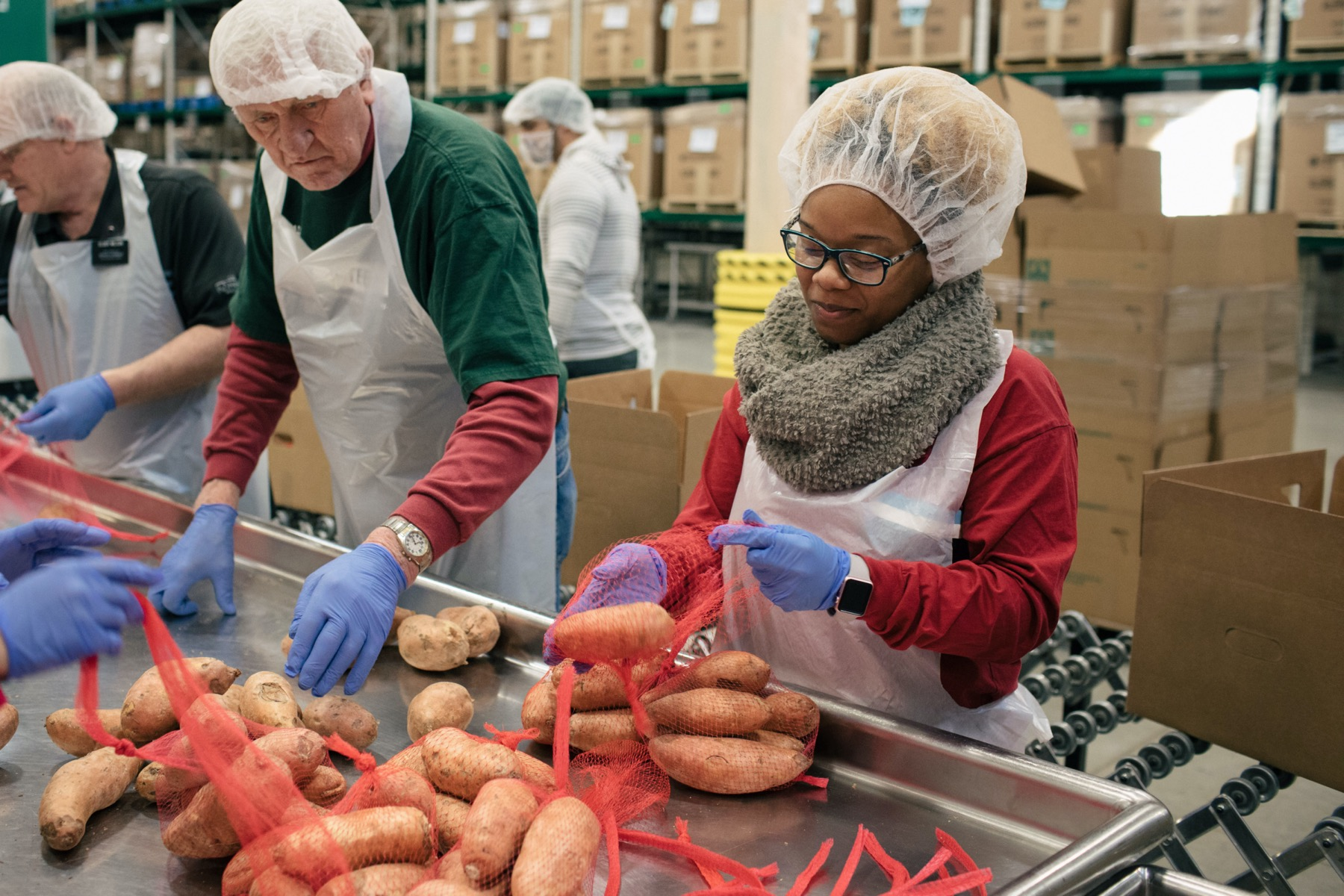 People packaging potatoes at the Greater Chicago Food Depository