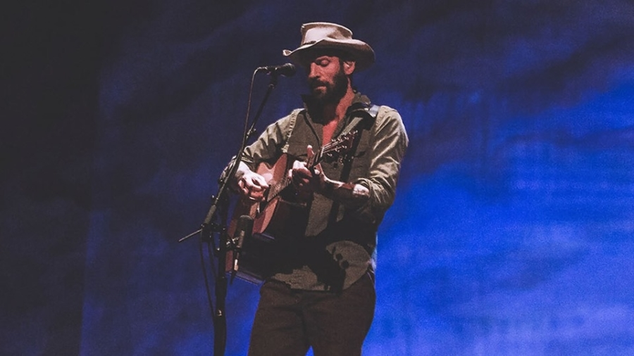 Ray LaMontagne playing guitar on stage for Just Passing Through tour