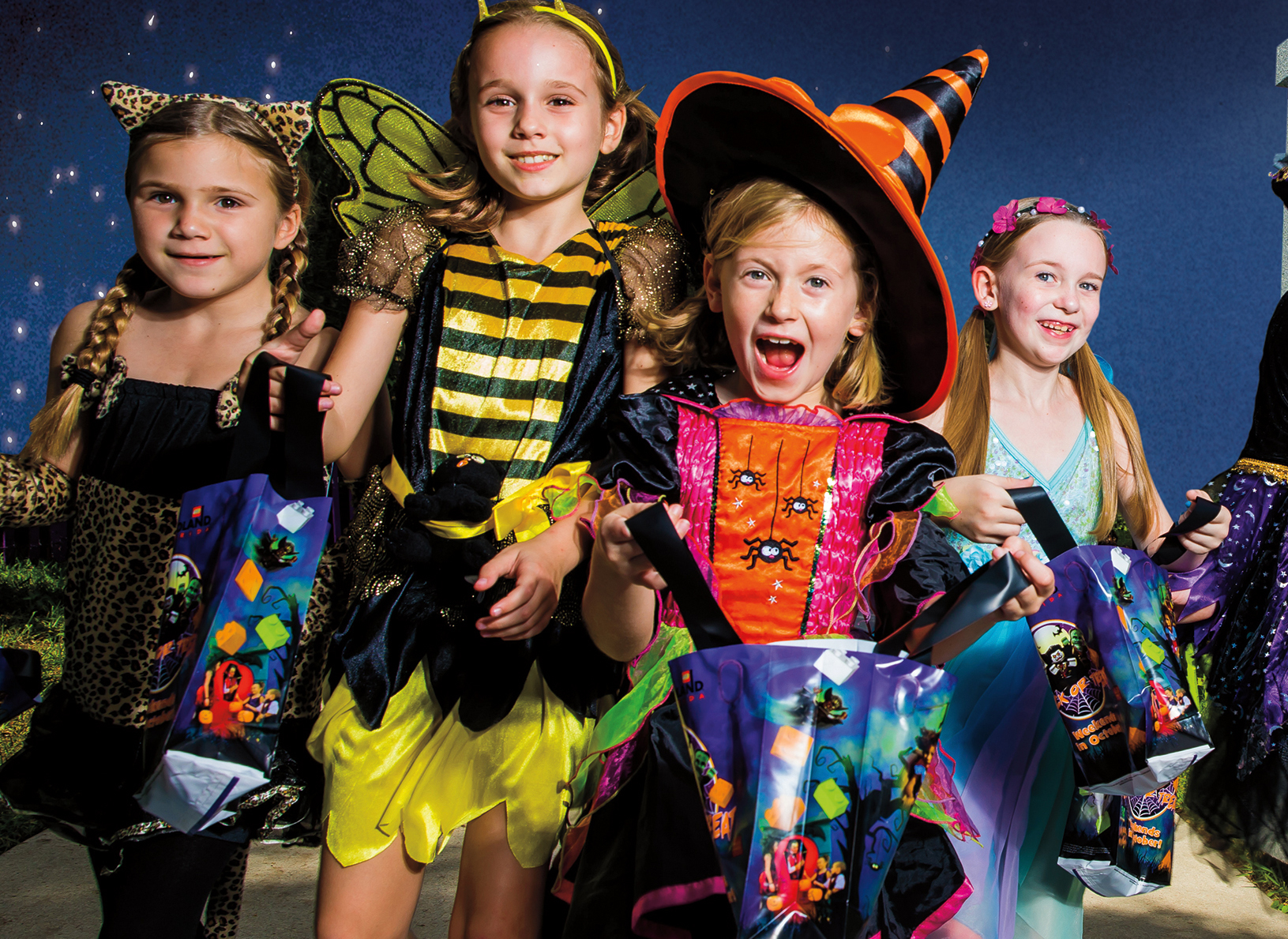 Kids modeling in Halloween costumes for Brick-or-Treat in Chicago
