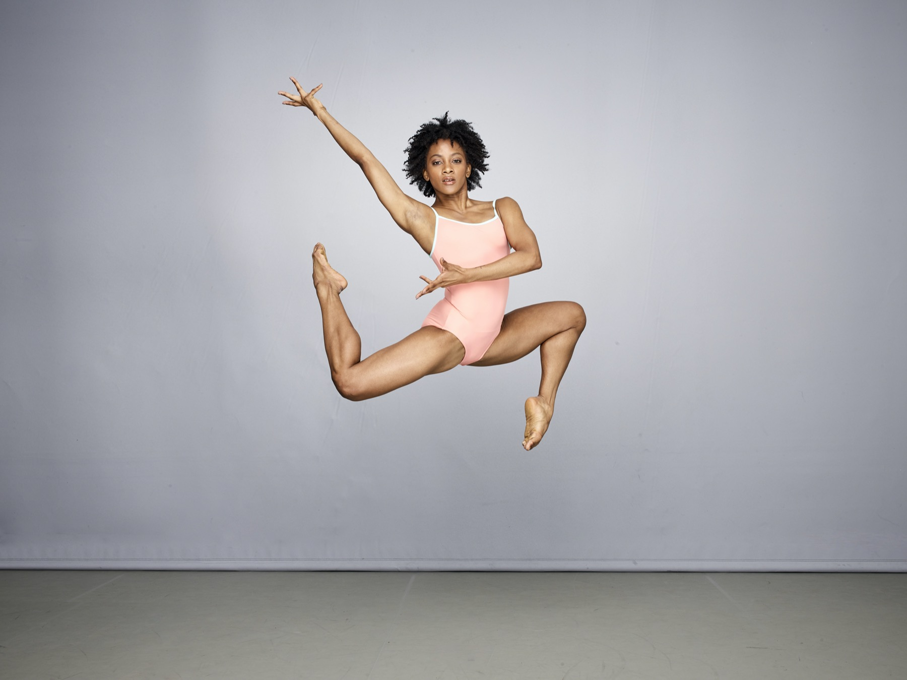 Alvin Ailey jumping in the air at the American Dance Theater