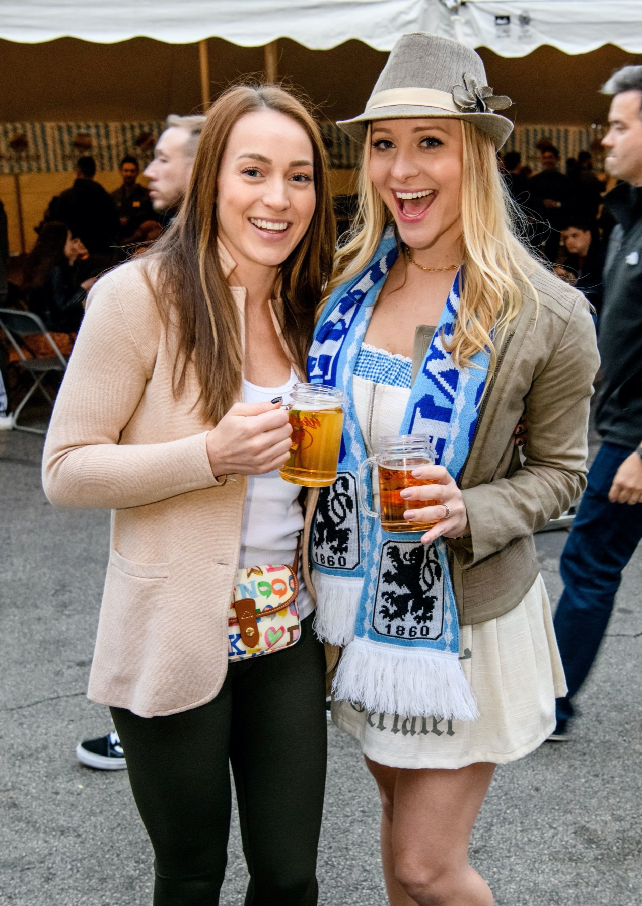 Two women dressed up for Oktoberfest Chicago with beers