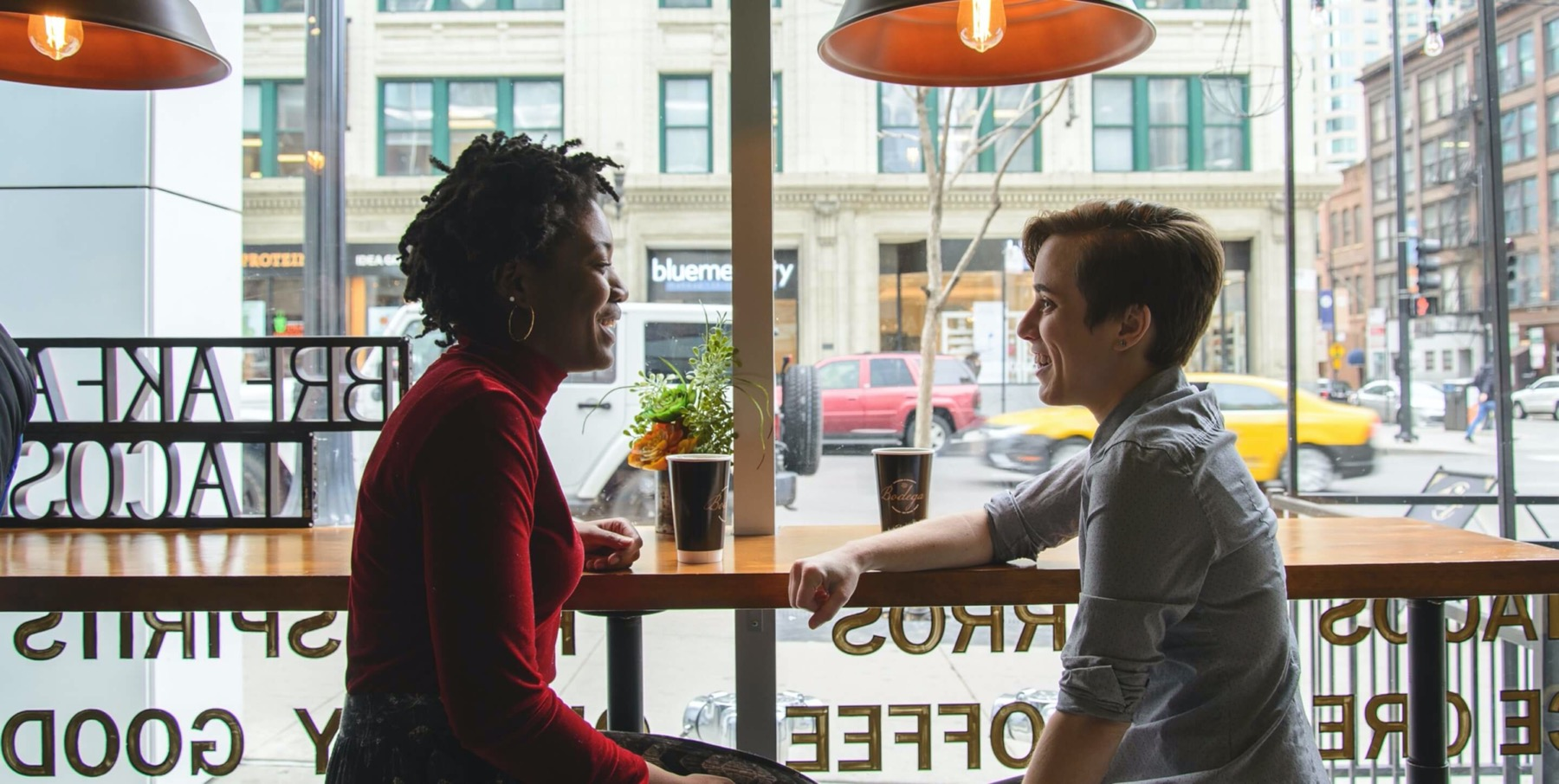 Two people talking in a coffee shop in Chicago