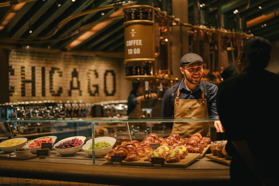 Man behind the food counter talking to a customer in the Starbucks Reserve Roastery in Chicago
