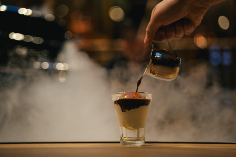 Person pouring coffee at the Starbucks Reserve Roastery in Chicago