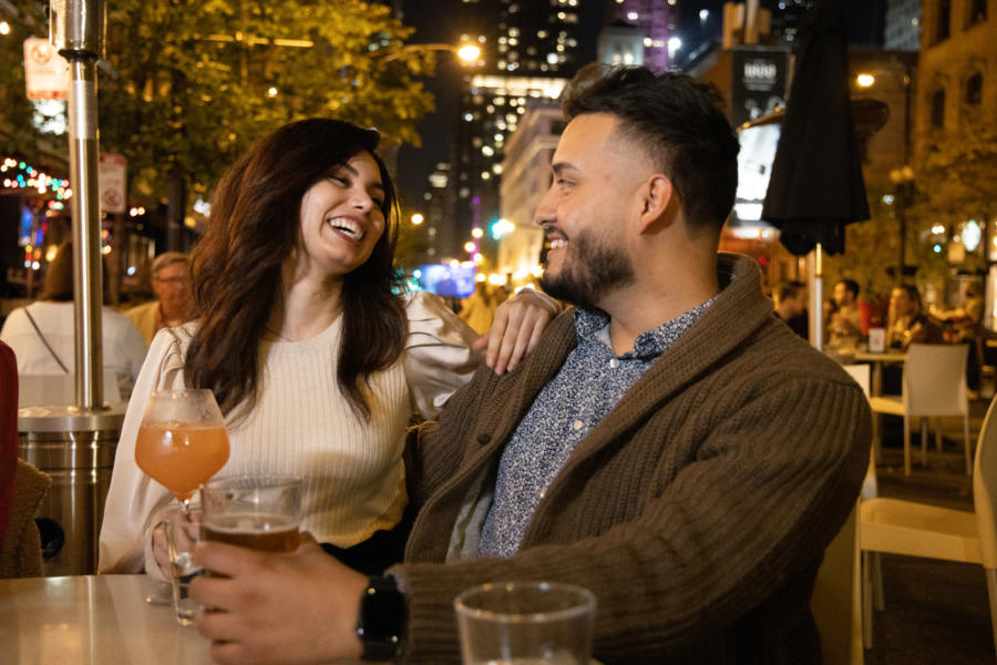 A couple dines outdoors at Bar Ramone