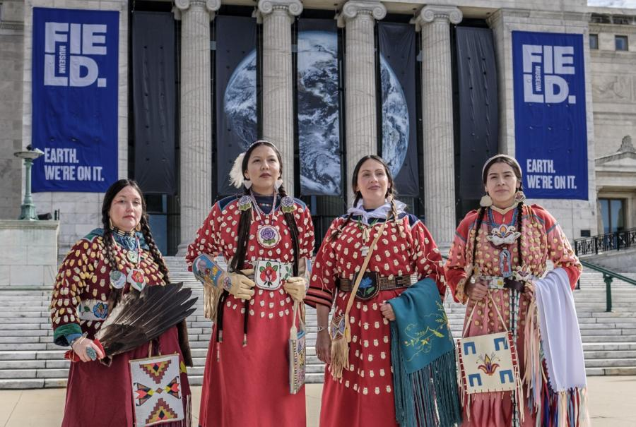 Photograph taken on the Field Museum's North steps of Apsáalooke Women and Warriors exhibition contributors including Phenocia Bauerle, Charmaine Hill, exhibition curator Nina Sanders, and JoRee LaFrance.