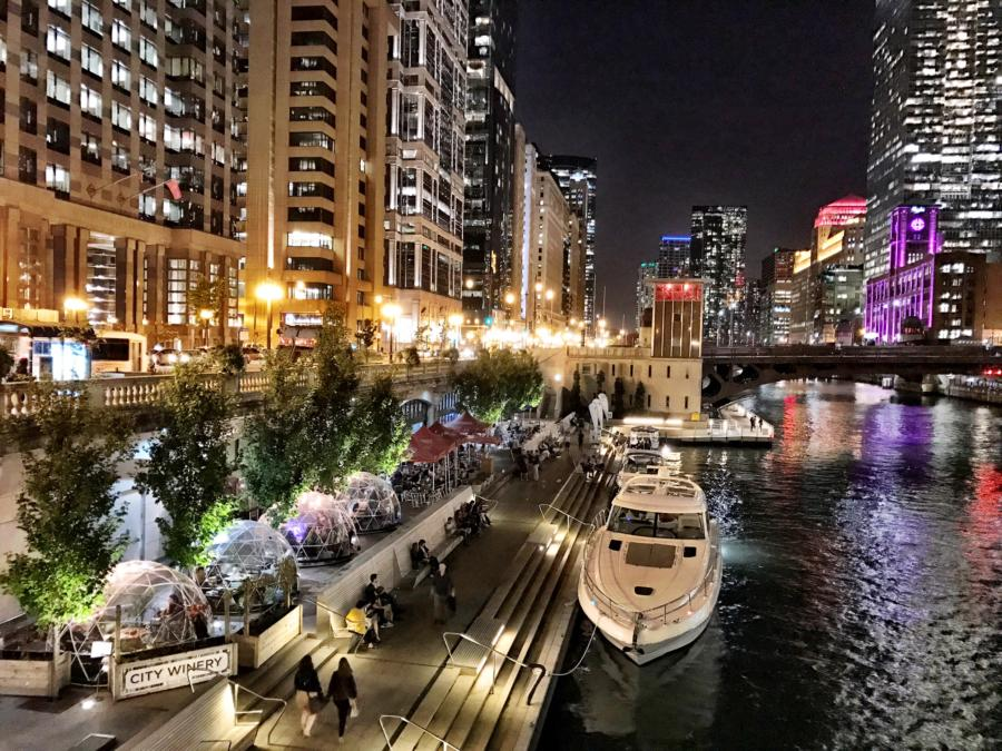 A nighttime view of the City Winery domes on the Chicago Riverwalk
