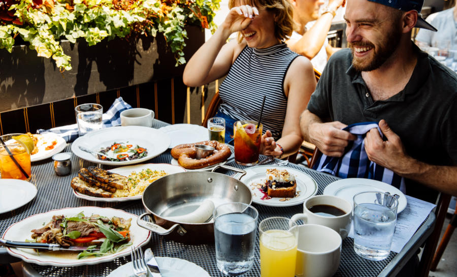 Friends dine on the Publican patio
