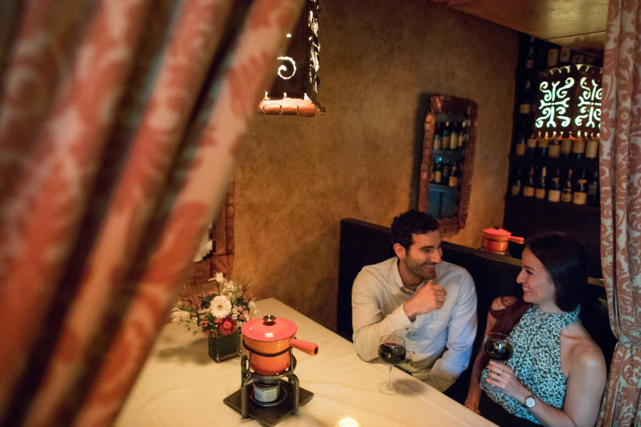 A couple enjoys fondue and candlelight at Geja's Cafe