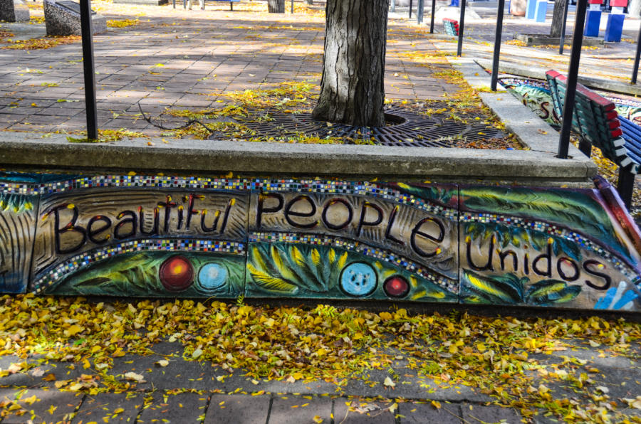 One of the murals reads 'Beautiful People Unidos' at Manual Perez Memorial Plaza in Chicago's Little Village.