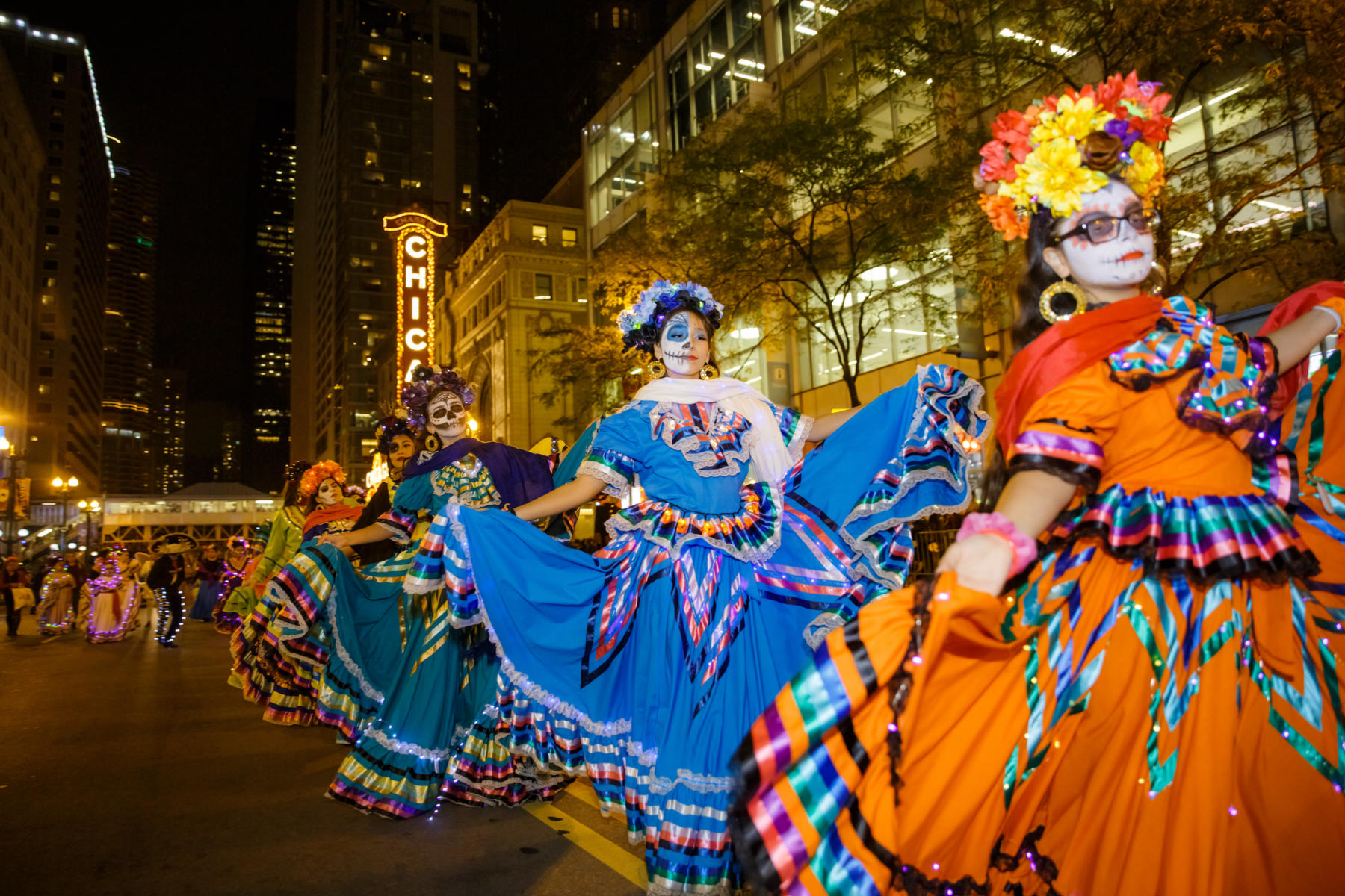 Smaller Ballet Folklorico Xochitl girls in a line at the Arts in the Dark parade