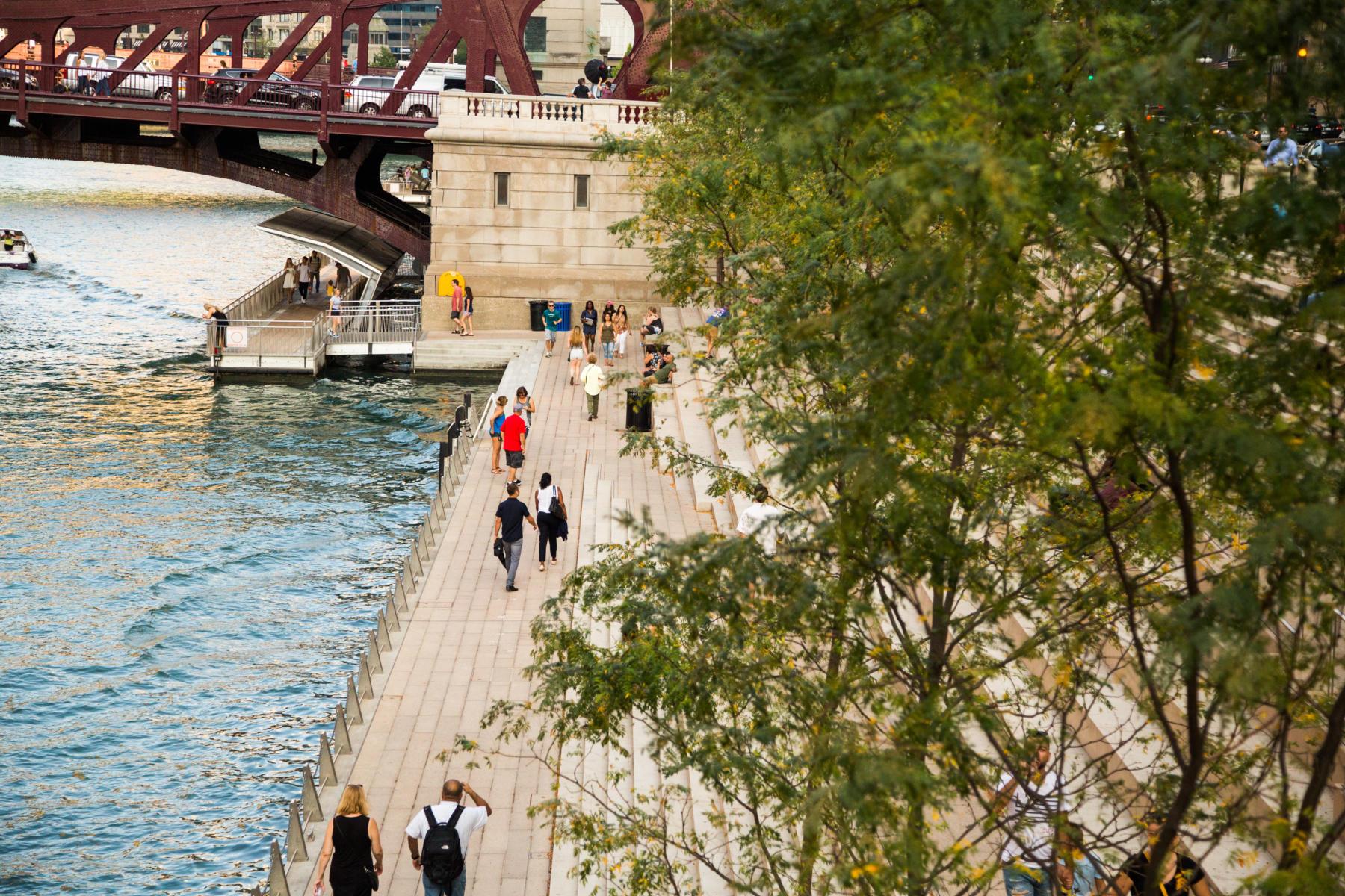 Pedestrians walk on the Chicago Riverwalk in summer