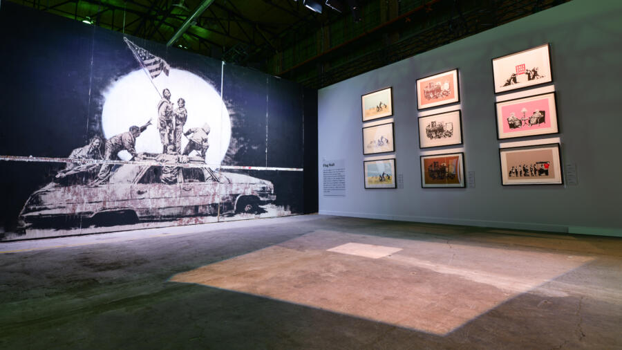 Image of the Flag Wall room at The Art of Banksy exhibition in Toronto.  Courtesy of The Art of Banksy.