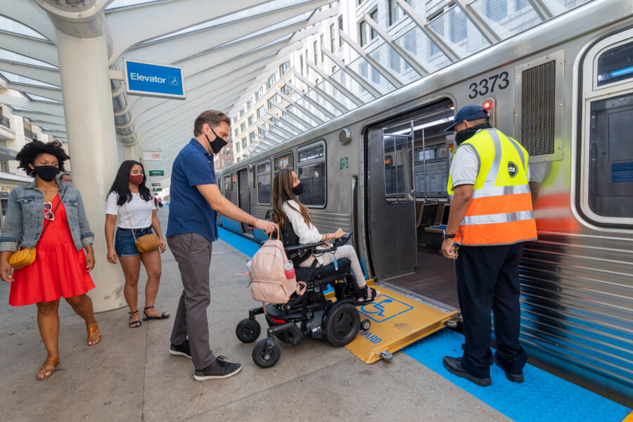 A visitor in a wheelchair at the Chicago CTA station